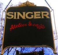 SINGER ATELIER & CAFÉ logo image